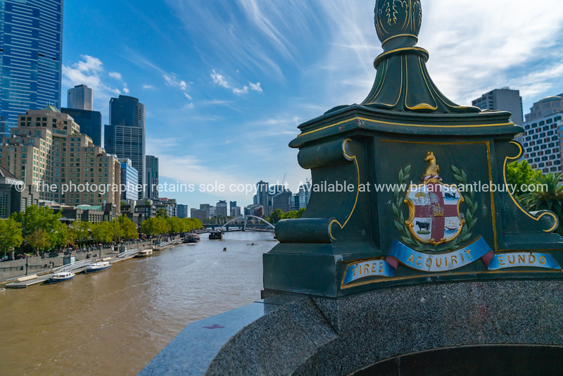 Princes Bridge with city coat of arms and motto which translates to  'We gather strength as we go'