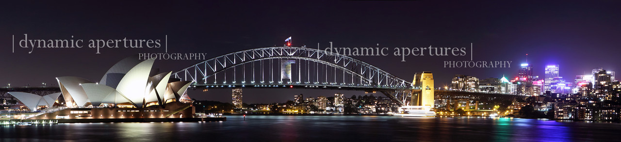 Panoramic view of Sydney Opera House and Harbor Bridge from near Mrs. Macquarie's Chair