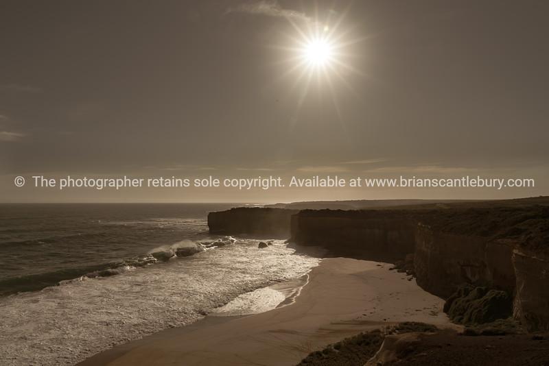 Sheer limestone cliff faces along Great Ocean Road coastal road trip