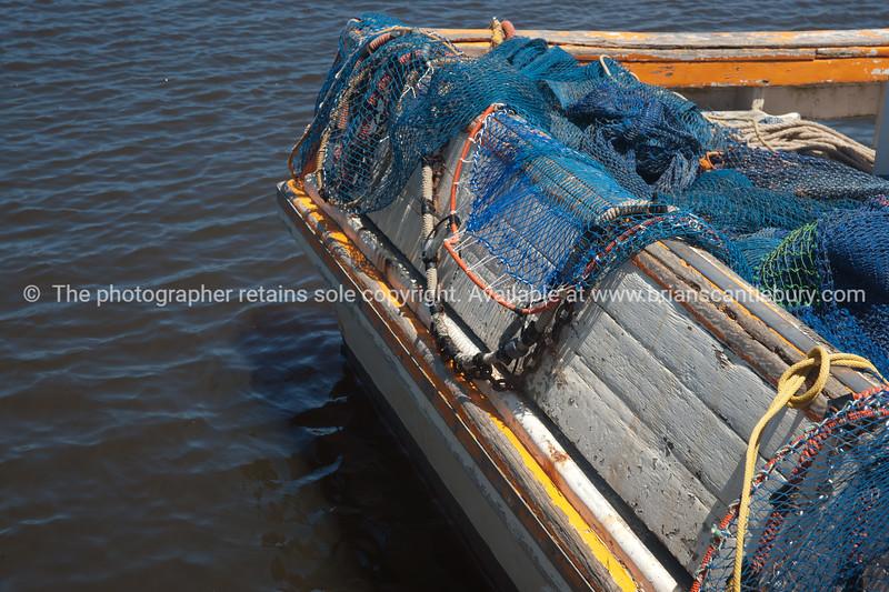 Prawn boat stern with nets draped. Yamba, Australia.