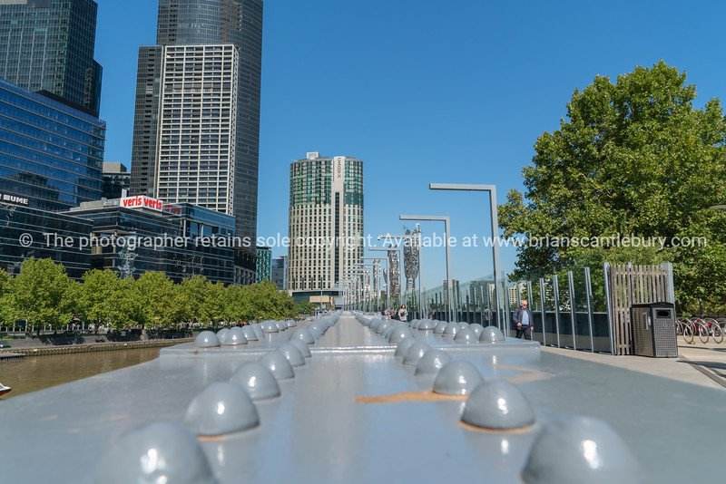 Melbourne Australia - March 10 2019; Structural raii  leading across Sandridge pedestrian bridge to Southbank on other side of Yarra River.