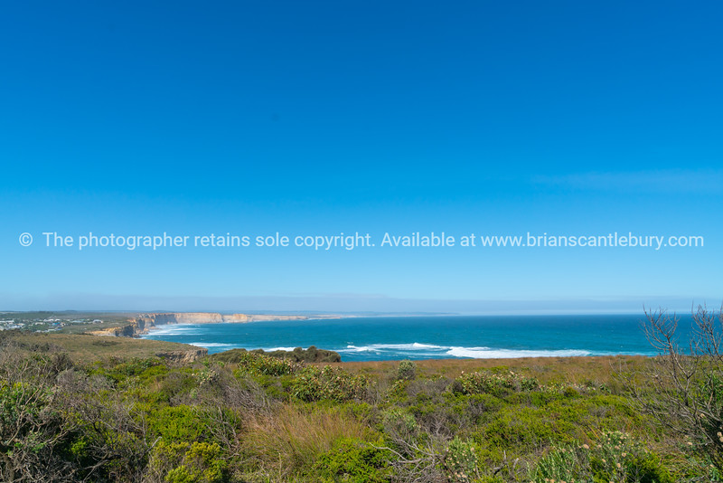 Long sweeping cliff along coastline of Great Ocean Road.