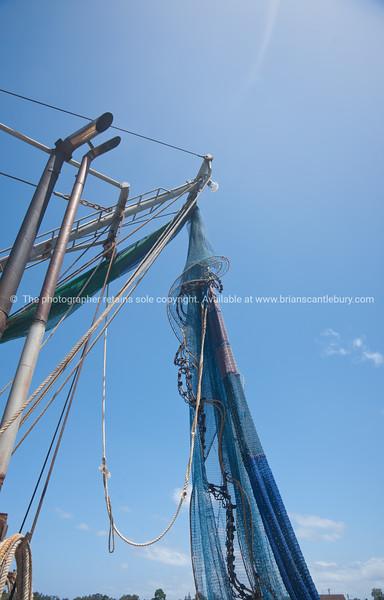 Prawn boat nets hoisted high, Yamba, Australia.