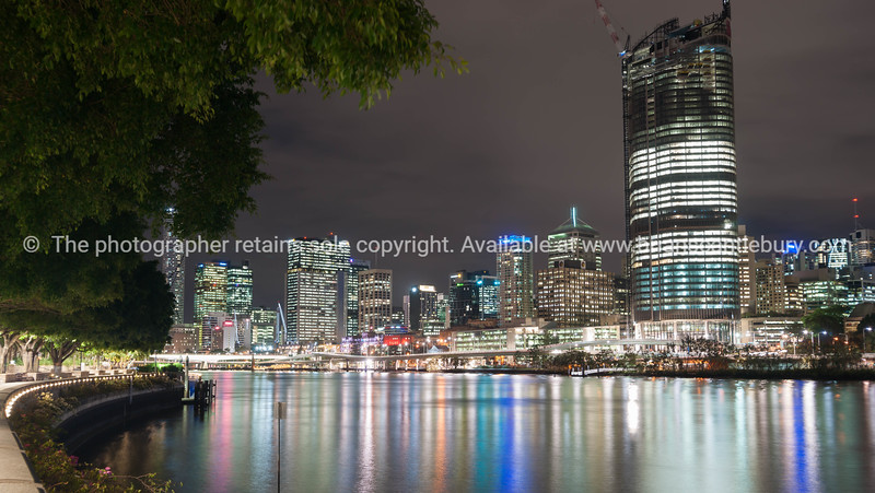 Brisbane city skyline lights across river at night from South Bank of Brisbane River