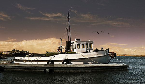 An old wooden fishing trawler ready to go to sea.