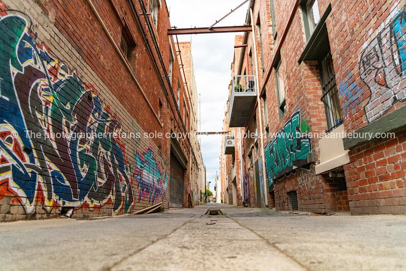 Melbourne Buildings  in inner suburb of Collingwood narrow street between old brick industrial buildings.