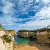 Sheer limestone cliffs drop to sea along coast of Great Ocean Road