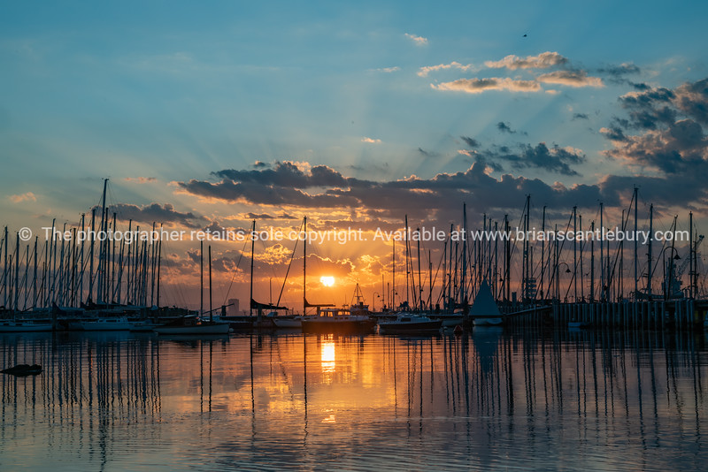 Sunrise over waterfront and boats