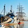 Steve Irwin Sea Shepherd ship docked with square rigged James Craig moored behind.