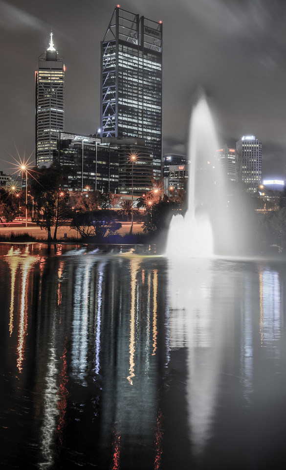Skyline of Perth, Australia. View from John Oldany park. Australian skyscrapers and lights reflected in the water.