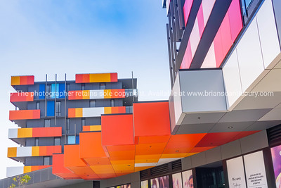 Striking red colors and interesting architectural lines on apartment blocks and commercial buildings