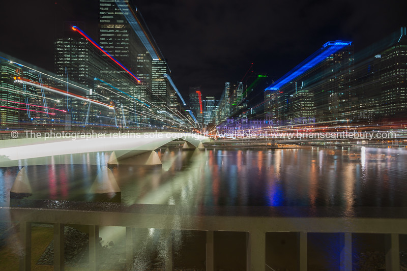 Brisbane Victoria Bridge catches night lights standing out against the dark night background