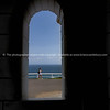 View through whitewashed structural arch on Cape Byron Lighthouse.