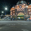 City landmark Flinders Street Railway Station on corner of Flinders and Swanston Streets at night