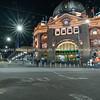 City landmark Flinders Street Railway Station on corner of Flinders and Swanston Streets at night