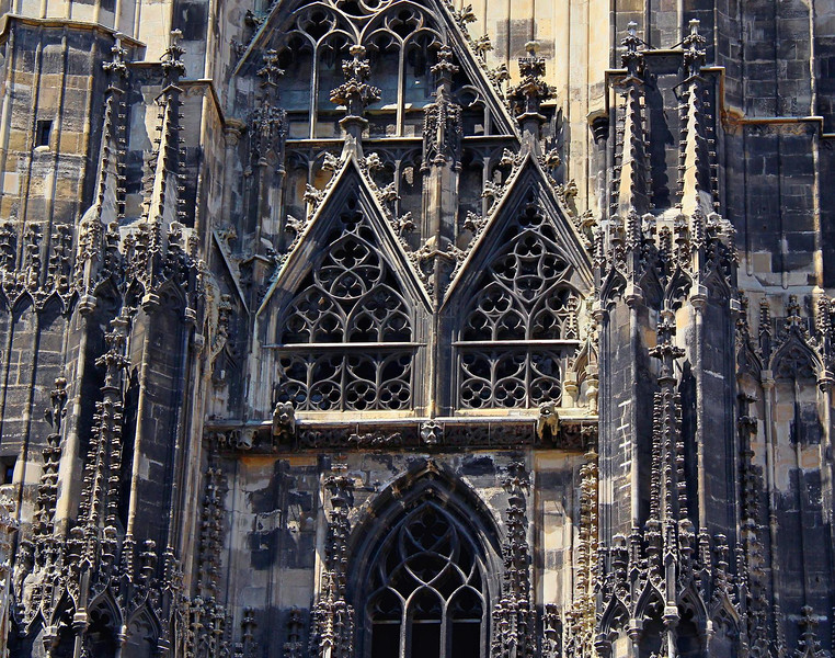 St. Stephen's Cathedral. Time and pollution have darkened the soft and vulnerable white limestone structure, but cleaning and restoration is underway. New techniques in restoring old buildings are allowing not only effective cleaning and color restoration without any abrasion, but they even keep the valuable patina of the original surfaces.