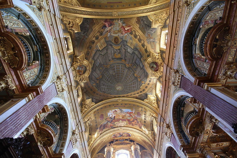 """Jesuit Church, Vienna. Bult in 1627, it was re-styled inside and out by famous architect, sculptor and painter Andrea Pozzo in 1703. Pozzo painted the gray trompe l' oeil """"dome"""" in the center of this photo, on a relatively flat part of the ceiling. Even in person it looks 3D."""