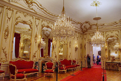 Schoenbrunn Palace, Vienna. Wolfgang Amadeus Mozart started at the top- right in this room in 1762.  On one of these couches, at age 6, he gave his first public concert (on the clavichord) to the head Lady of the land, Empress Maria Theresa. Word of his prowess spread quickly, and his legend had begun.