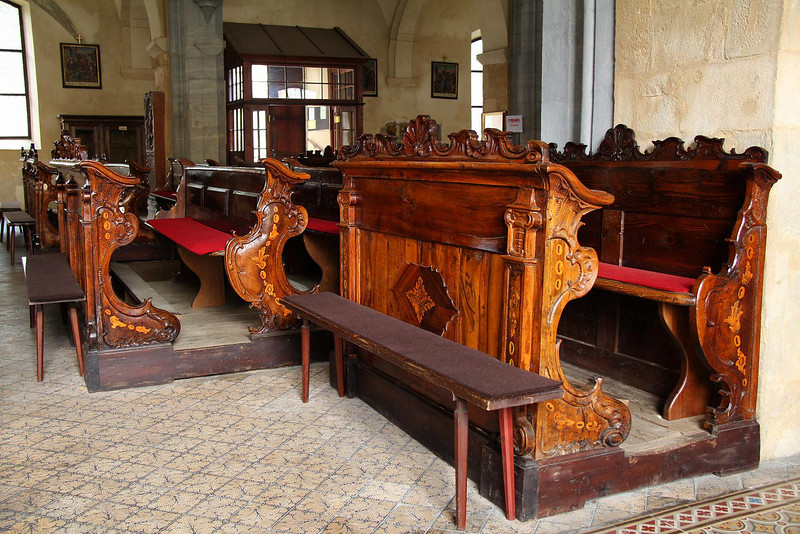 Very old pews in St. Bartholomew's Catholic Church in Friesach, Austria.