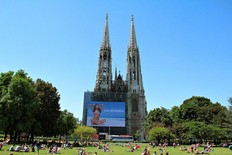 Victoria Secret's famous photographer Russell James took the billboard shot that front-covers the massive Votivkirche in Vienna. The badly needed restoration is funded largely by Calzedonia, an Italian swimwear and hosiery company. Not sure what Jesus would say, but the end results should please many.