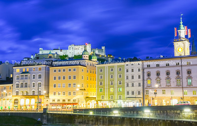 Urban night light glow across Salzach River