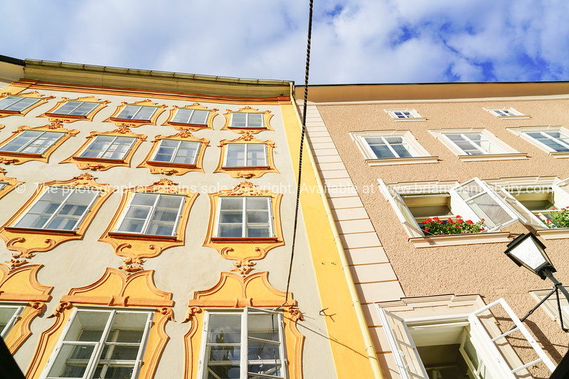 Low point of view of traditional building facades in old town area salzburg.