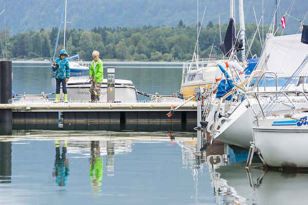 Boats ready for hire and waiting tied to pier on pcturesque Lake Mondsee