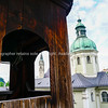 View through window to buildings and church dome from catacombs in Salzburg