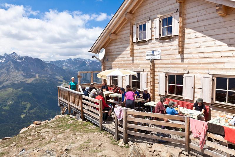 Sitting on the terrace of Brunnenkogelhaus hutte (2,738 metres)