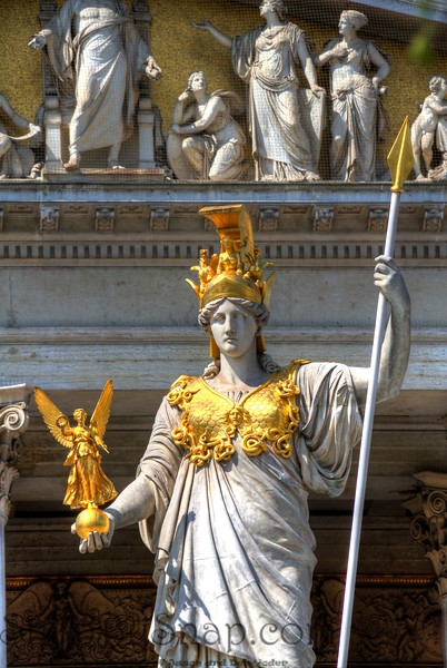 Statute of a Woman with Gold