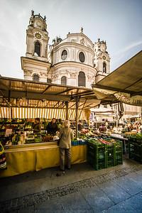 Open air market with the Kollegienkirche in the background.  Salzburg, Austria.
