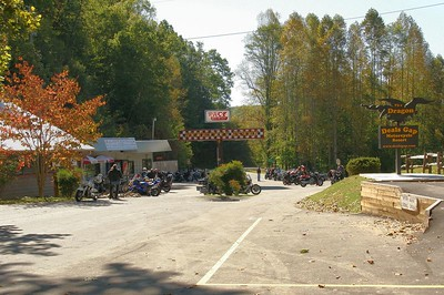 """Some bikers at Deal's Gap Motorcycle Resort getting ready to ride the """"Tail of the Dragon."""" This road (US route 129 in TN) is renowned in motorcycle circles for having 318 curves in 11 miles. As of 8/31 3 bikers died during 2005 on this road. 2 went over the banks and 1 hit another vehicle. miata also runs some events here."""