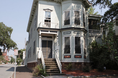 This house on E. Hall Street, one block from Forsyth Park and the southern edge of Savannah's historic district, operates as the Savannah Pensione.  Cheap rooms in a nice neighborhood.  © Shams Tarek (www.shamstarek.com)