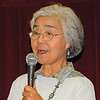 Hideko Metaxas; October 2004 at the Yamato Bonsai Club show; Interpreting for Masahiko Kimura, the visiting bonsai demonstrator.<br /> <br /> Hideko-san is an expert in the Japanese cultural arts of ikebana, suiseki, and bonsai and is in demand around the world to lecture and also interpret for visiting Japanese artists.<br /> <br /> Hideko-san arranged for us to visit her sister's family (the Iwatas) in her hometown of Yamagata.