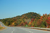 An autumn view from the passenger seat of a highway in Vermont, United States