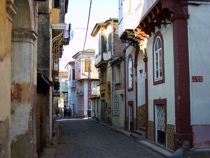 This is a typical ancient style street in Ayvalik. Notice the really old style architecture...<br /> Ayvalık (Greek:  Aivali) is a seaside town on the northwestern Aegean coast of Turkey. It is a district of the Balıkesir Province. It was alternatively called (Kidonies) by the town's formerly important Greek population, although the use of the name Ayvalık was widespread for centuries among both the Turks and the Greeks (pronounced as Ayvali by the latter).