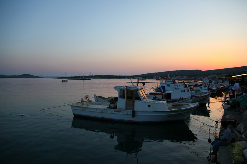 Pity that the water was not like  a mirror. Still a nice shot. Cunda Island harbour. Fishing boats.