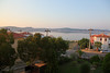 A shot from our balcony in the SARAY Hotel on Cunda Island) at around 7 in the morning. In the distance you see the village of Ayvalik. This area is famous for it's olives and related products.<br /> <br /> See the doghouse? (lower left corner). This dog was really a monster...