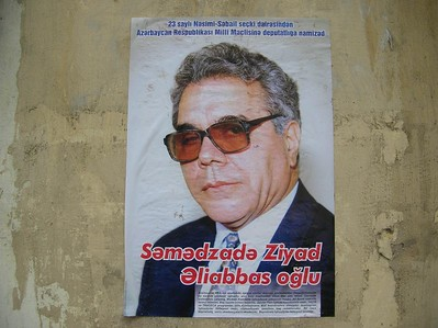 One of the many posters in Baku for candidates in the upcoming Parliamentary elections.