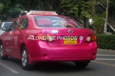 ALL TAXI's are Toyota's and all are bright colors.