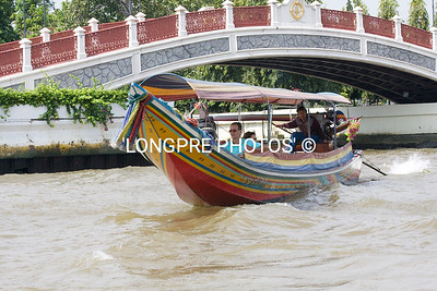 LONG BOAT on canal.