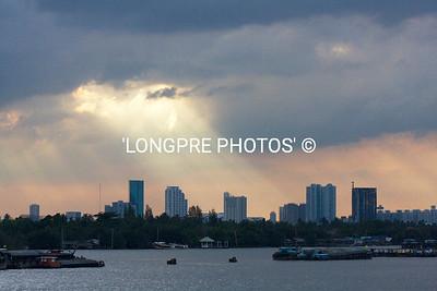 Sunset over Bangkok from river.