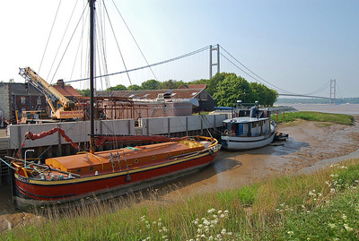 The old and the new. The bridge killed off the ferry and much of the freight that was once carried by boat across and down the estuary. I love this old sailing barge, converted into a beautiful mobile home.