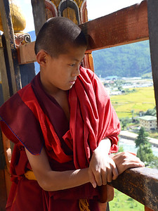 Monk by monastery window.