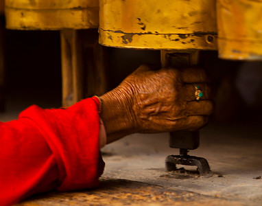 hand are constantly turning the prayer wheels all over Bhutan