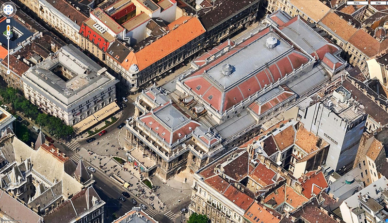 """17-Aerial view of Hungarian State Opera House, 1884. Canopy marked """"Veuve Clicquot"""" is Belcanto Restaurant, where I ate after touring the Opera House. Új Színház (the New Theatre) is one block to the lower left (off the photo)."""