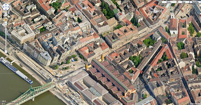 43-From lower left to upper right: Liberty Bridge, Great Market Hall, and dark diagonal street points to steeple of Reform Templon. (Google maps)