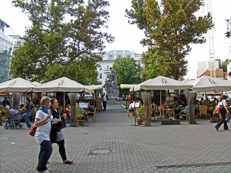 55-Vörösmarty Square. In the center is a marble statue of Hungarian poet and writer, Mihály Vörösmarty. The square is centrally located behind major hotels on the Pest Embankment. (The Marriott is immediately to the left of this photo.)