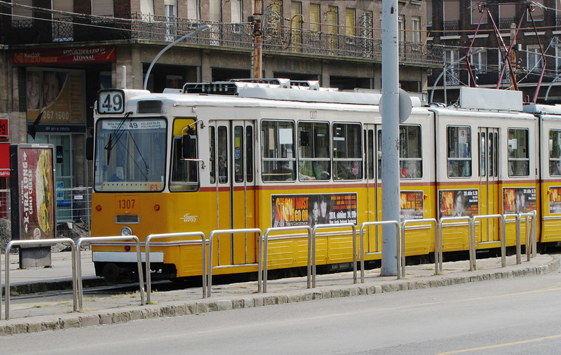 05-On Karoly Korut, Tram No. 49 heads to the left to Deak Ferenc Square