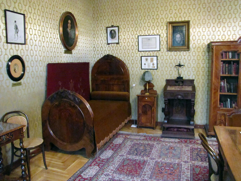 13-In the museum, we see Liszt's prayer stand (right) and bed (corner). Moving around to the left...